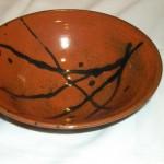 Khaki glazed bowl with black design